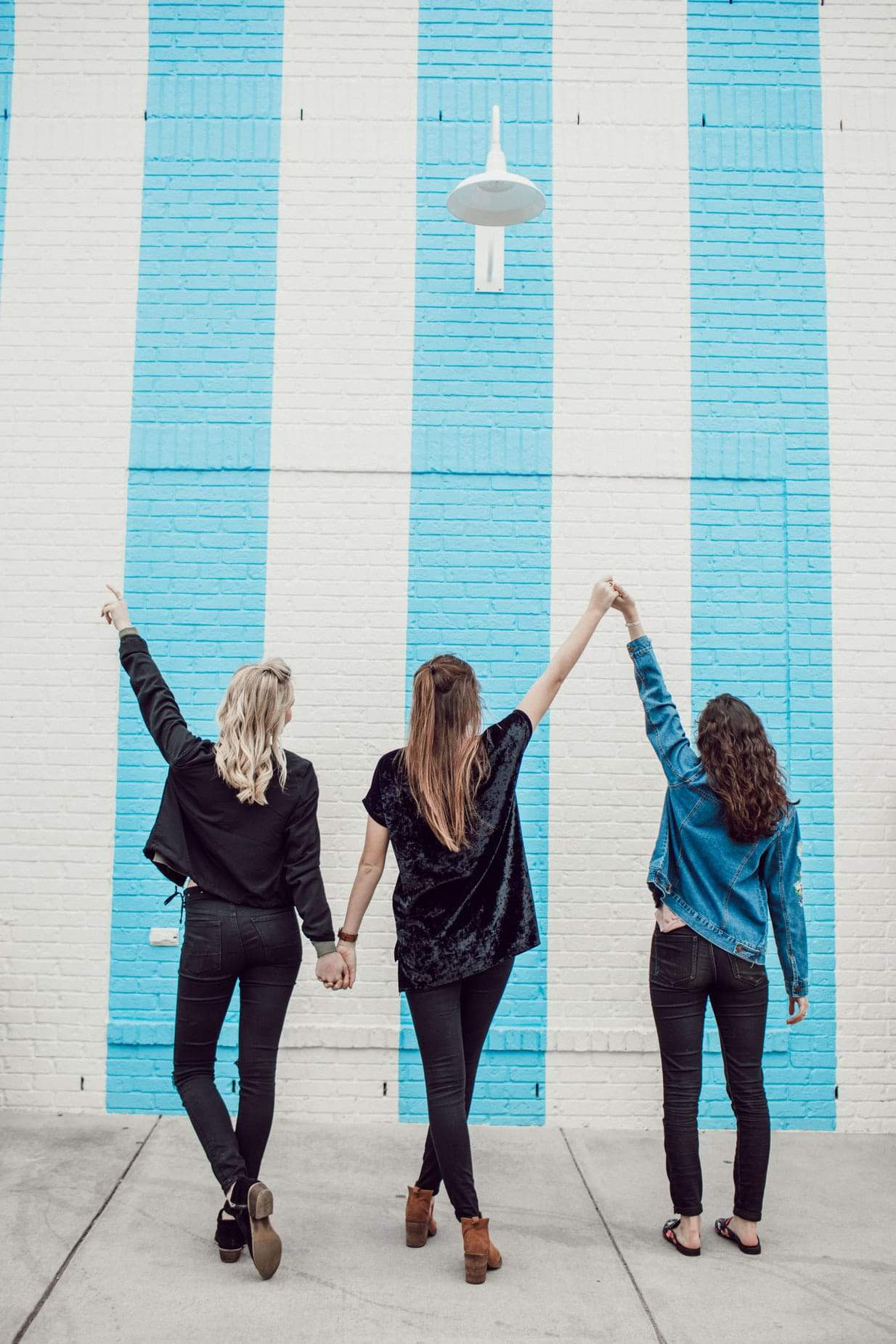 Friends together making hand signals